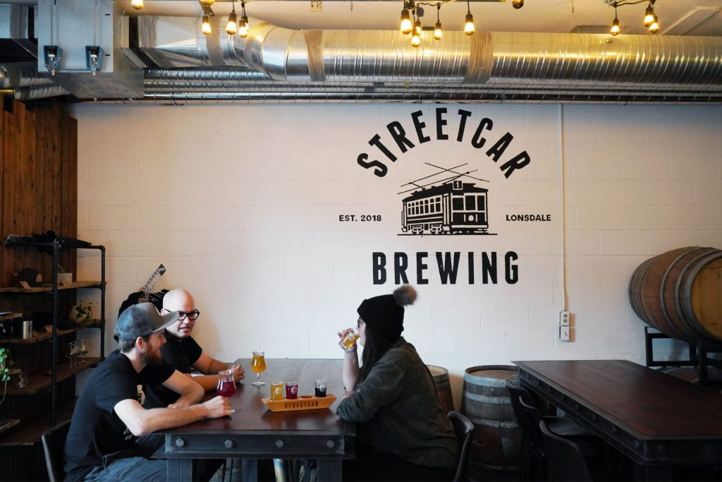 Group of friends drinking craft beer at Streetcar Brewing