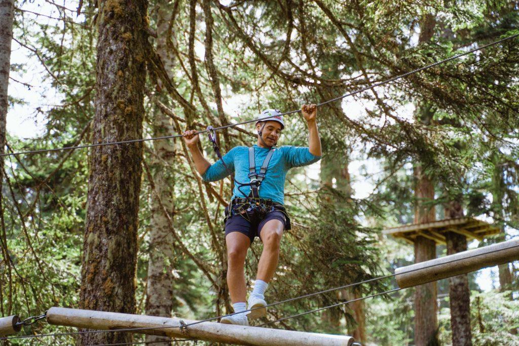 Man on treetops adventure on Grouse Mountain